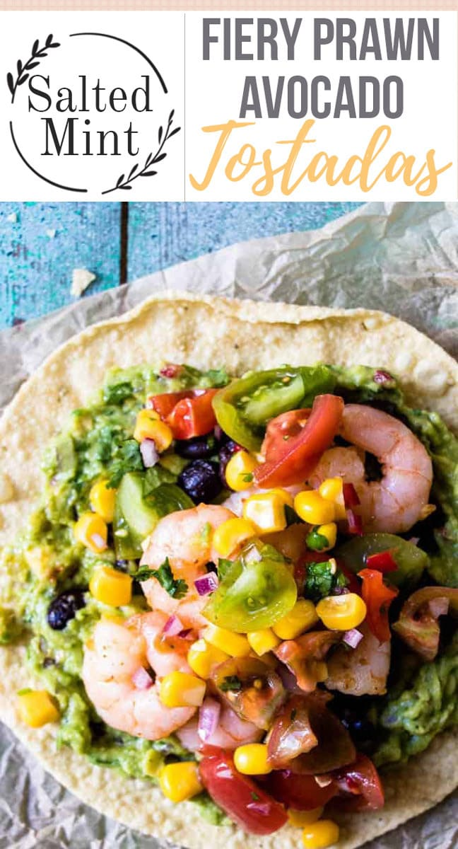 These prawn and avocado tostadas are perfect for game days. Creamy guacamole, juicy and spicy prawns with corn and black beans. The perfect appetizer or party snack. #quickrecipe #easyrecipe #appetiser #easymeal