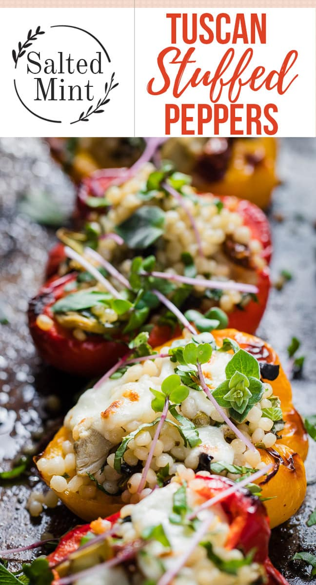 These vegetarian stuffed peppers are perfect for a clean eating diet. Packed with herbs and topped with cheese these are healthy and delicious. #cleaneating #vegetarian #stuffedpeppers #dinner #easyrecipe