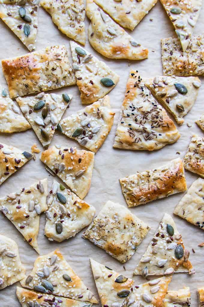 Simple homemade flatbread crackers. Topped with seeds and spices for flavour and texture. Perfect for cheese and dips or as a hostess gift.