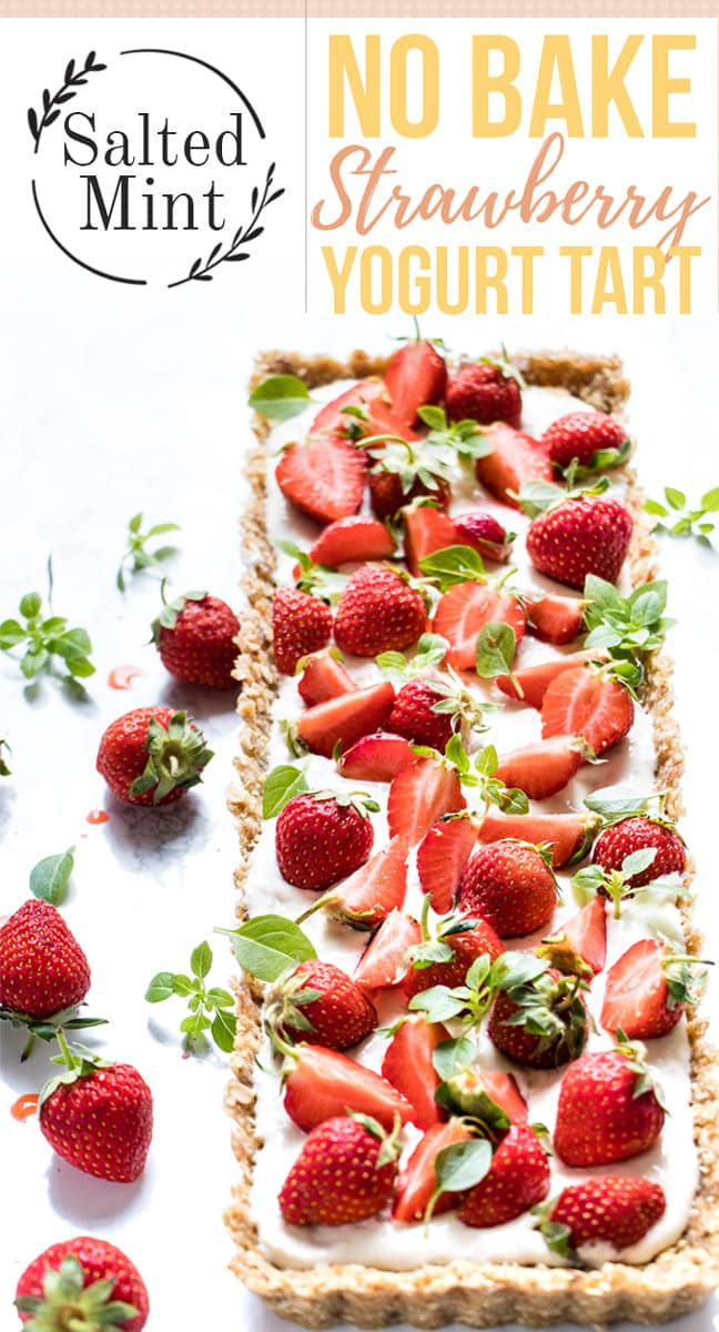 This no-bake strawberry tart recipe is a simple no bake healthy treat. Inspired by the French style tart, this one uses Greek yogurt for a filling instead of cream to keep it light and fresh. Decorate it with fresh flowers and some basil leaves to make it the perfect picnic treat. #tart #strawberry #dessert #picnicfood