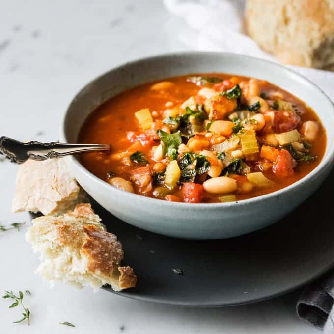 Hearty white bean minestrone is a veggie loaded warming spin on the Italian classic. This soup is full of veggies and protein to keep winter colds at bay and it's got a depth of flavour from pancetta and cavolo nero. A nod to classic Italian ingredients.