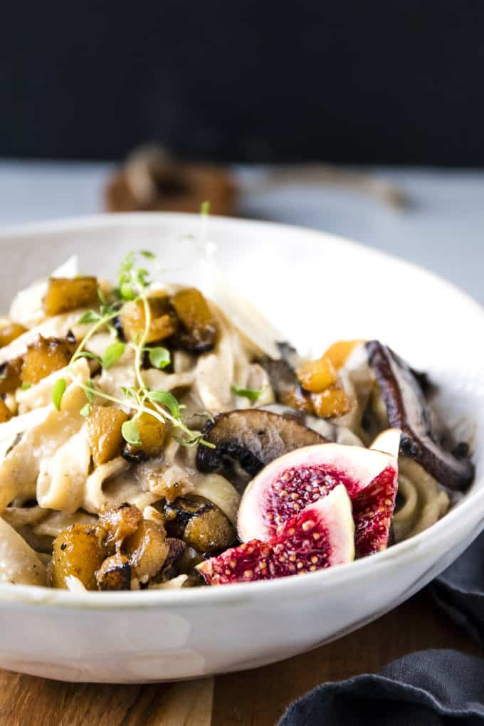 This roasted cauliflower & pumpkin fettuccine Alfredo is the perfect cosy pasta night in. A quick dinner of noodles snuggled into creamy roasted cauliflower sauce with sweet and earthy roasted pumpkin and deep flavoured mushrooms and juicy figs.