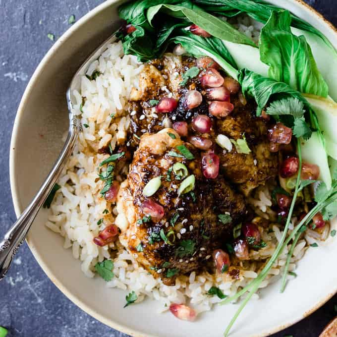 This sticky Asian pomegranate chicken is the perfect one pot meal. It's a delicious balance of sticky sweet ginger garlic sauce and tart pomegranate molasses. It's a one pot 30 minute dinner that will be a new family favourite.