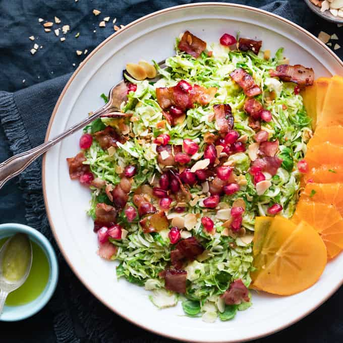 It's delicate shaved sprouts, warm and crispy bacon and bright citrus vinaigrette with toasted almonds.