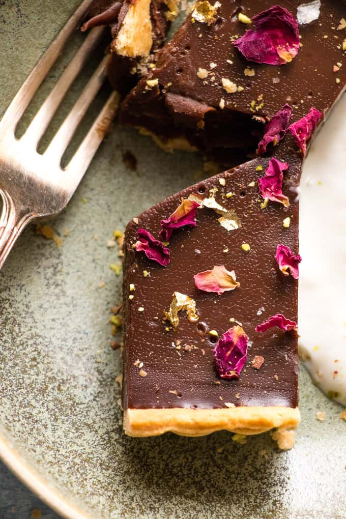 This is the creamiest dreamiest chocolate truffle tart that you will ever eat. Dark smooth chocolate, in a crispy flaky crust, topped with hazelnuts.