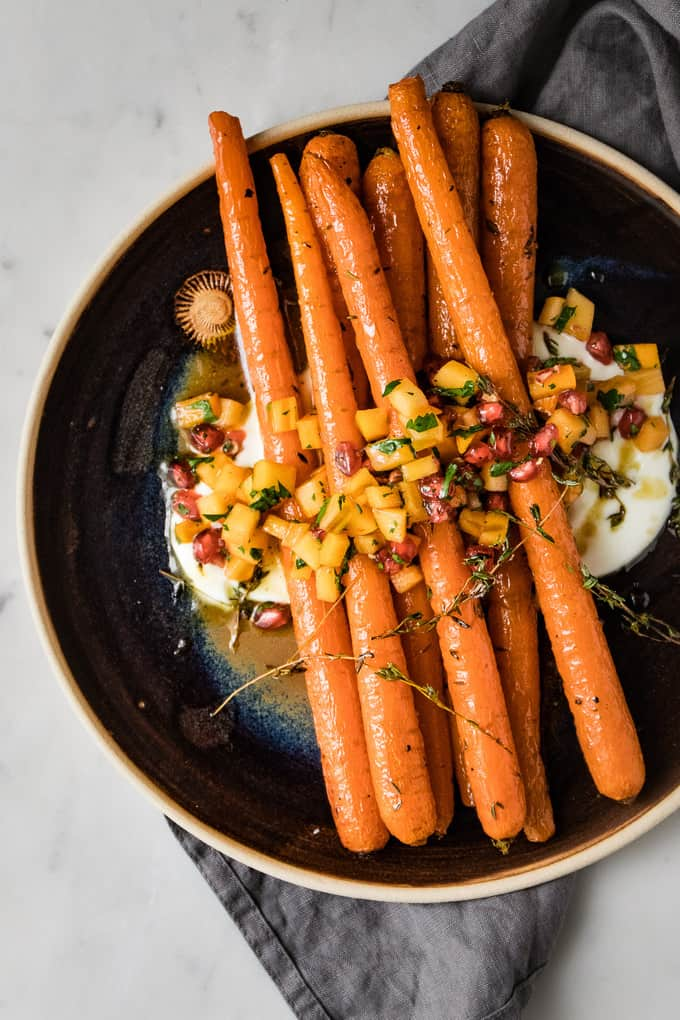These honey and thyme roasted carrots are the perfect addition to any table. But especially perfect for the holidays. Earthy carrots, sweet caramelised honey and savoury thyme roasted to sweet perfection.