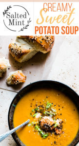 creamy spicy sweet potato soup with spoon and shrimp