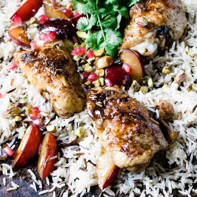 This chicken and pomegranate chicken sheet pan dinner is the perfect sweet and sour chicken with a twist. Low fat and simple to make in 30 minutes.