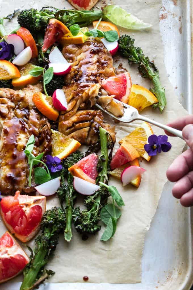 We're chasing winter blues away with bright and tangy winter citrus and Asian hoisin glaze. This citrus hoisin glazed roasted sheet pan cod is a one pan dinner takes less than 30 minutes to make.  It's completely gluten and carb free. It's perfect for cold January nights, but is completely diet friendly.