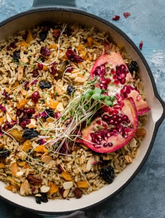 This simple Moroccan rice pilaf is a one pot rice wonder. Fragrant with spices, nuts and dried fruit it's simple enough for weeknights and hearty enough to be dinner on it's own. A totally vegan, whole grain dish made with brown rice and spices. #plantbased #moroccan #rice