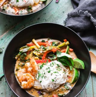 Bowls of red thai curry noodles