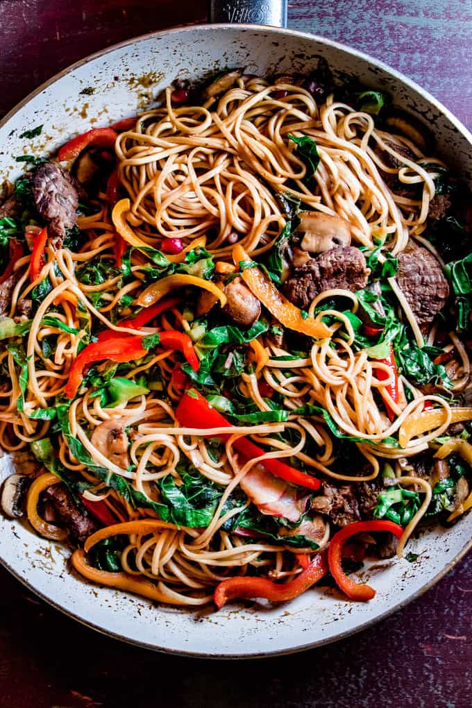 This sweet n' spicy Korean stir fry is food truck greatness, right here. Saucy noodles, bright crunchy veggies and a spicy sweet sauce made with ginger, garlic and Gochujang. It's a perfect weeknight dinner because it's ready in only 20 minutes.