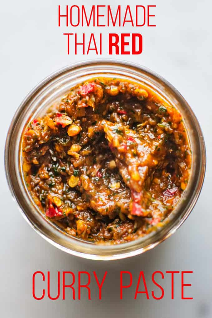 jar of homemade thai red curry paste in a jar on a white background with text overlay