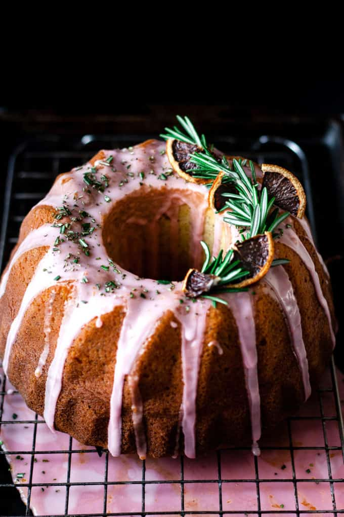 Blood orange rosemary bundt cake on cooling rack.
