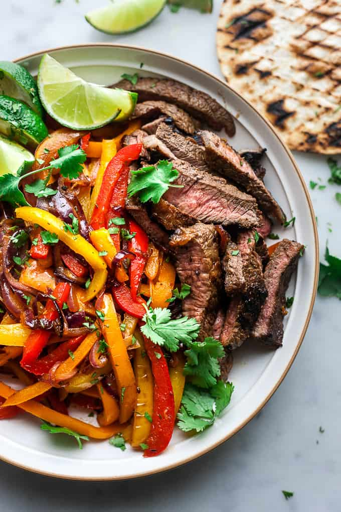 Marinated grilled beef fajitas in a bowl.