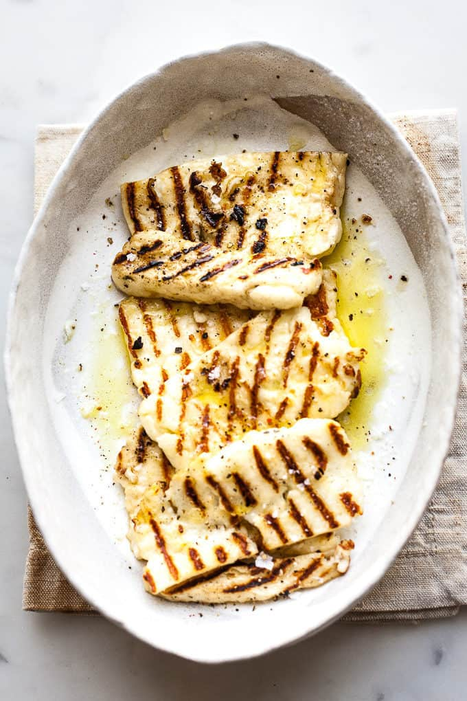 Grilled halloumi in a bowl with olive oil