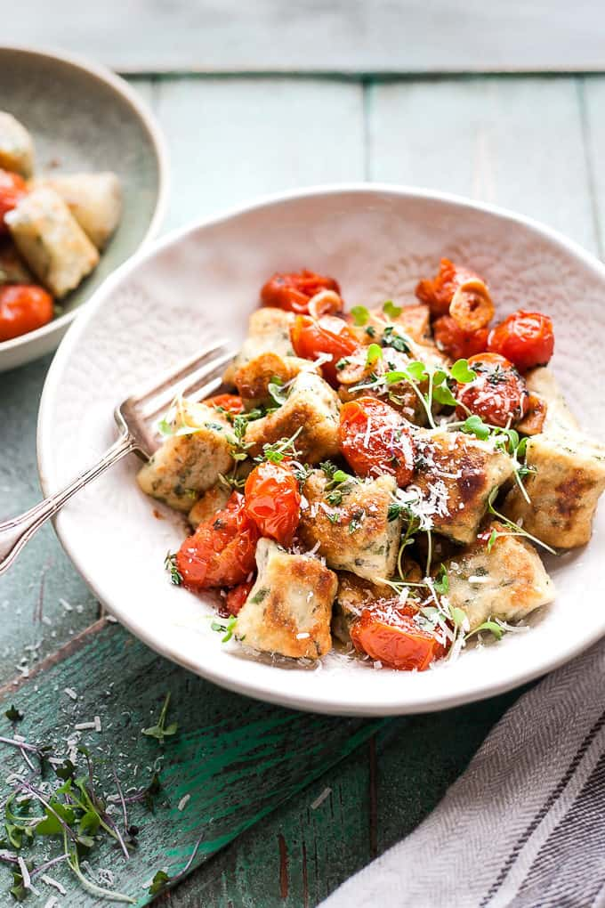 Ricotta gnocchi in bowl with a fork.