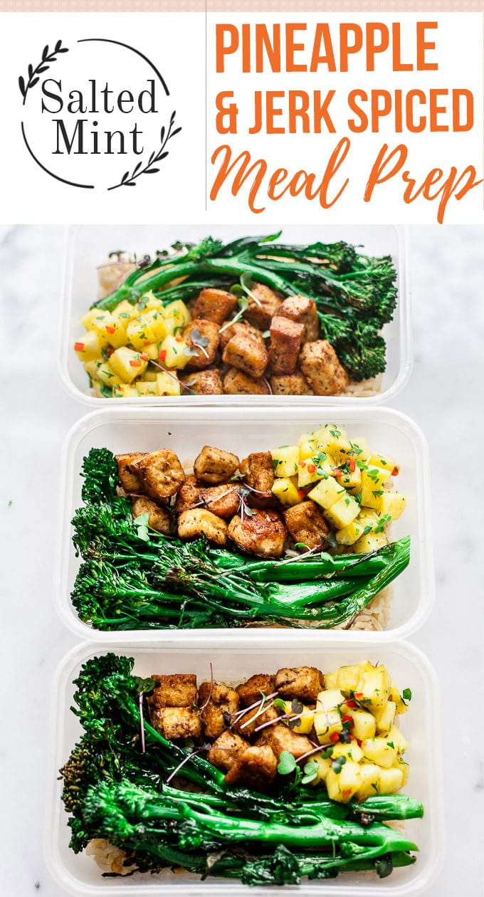 These vegan meal prep bowls are the perfect for a week of healthy lunches. Crispy jerk tofu with spicy pineapple slaw and brown rice. So easy to make. #lunch #mealprep #mealprepmonday #vegan #vegetarian