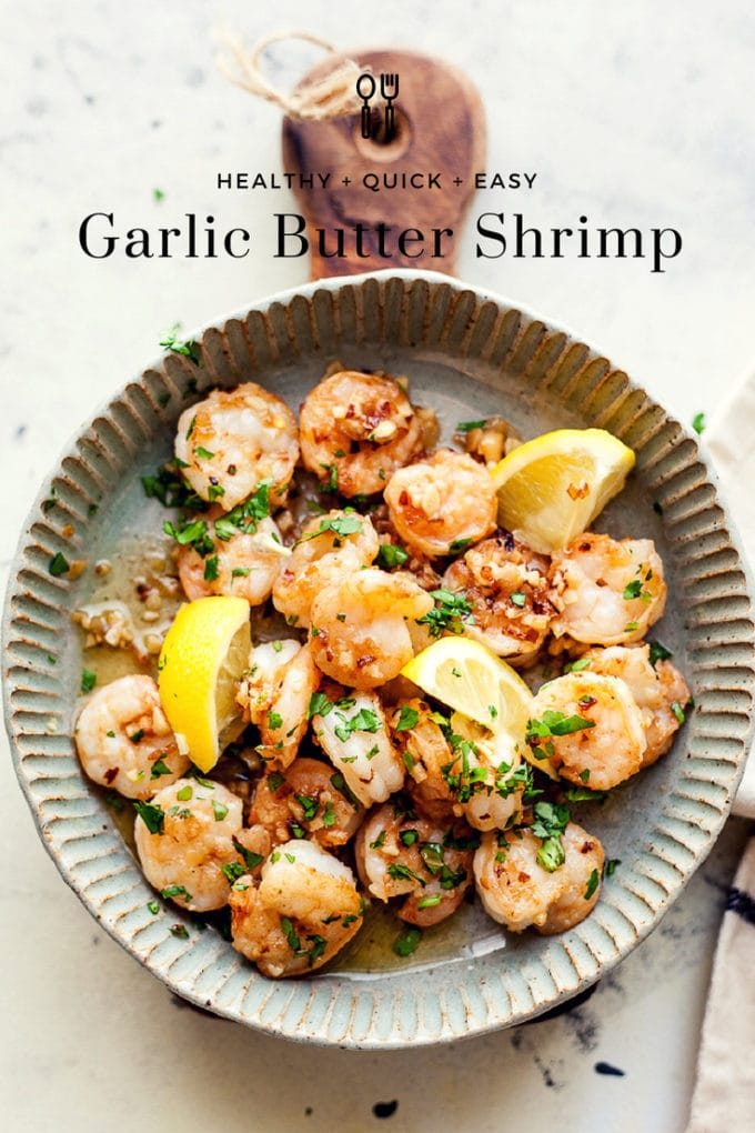 Garlic Butter Shrimp In a Dish with parsley and lemon with text overlay.