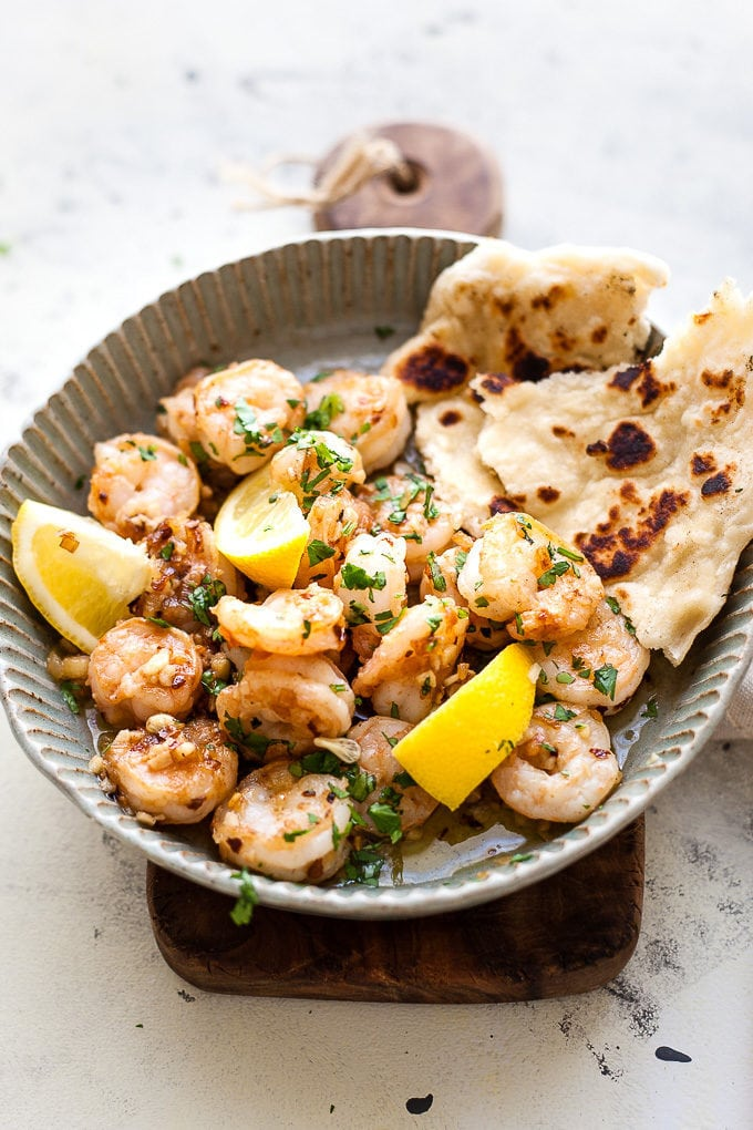 Garlic Butter Shrimp In a Dish with parsley and lemon