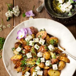 Greek Roast Potatoes with feta in a bowl