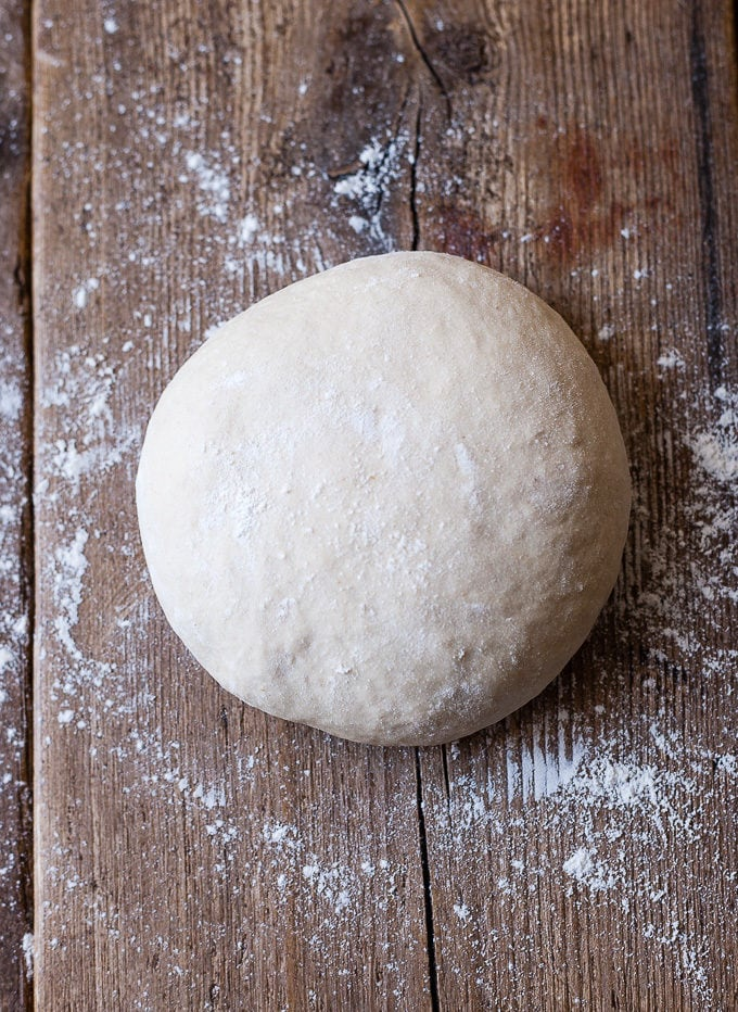Ball of best Italian Pizza dough on a wood board.