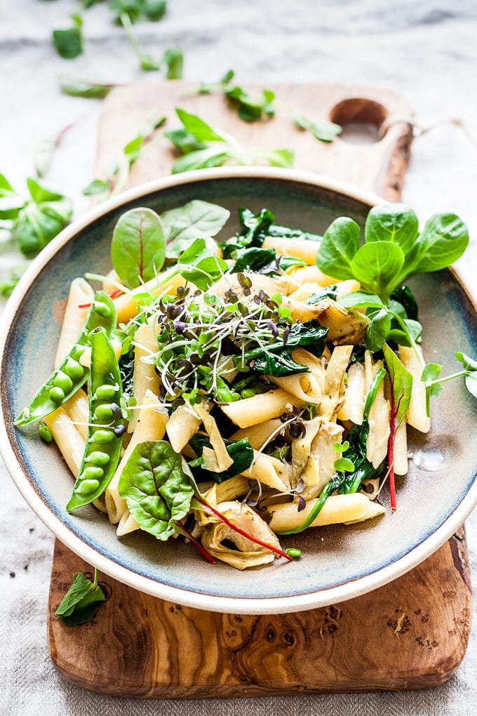 Artichoke pasta in a bowl with greens