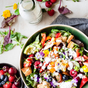 Garden Salad with fruit and dressing.