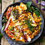 Asian salad with noodles in a bowl.