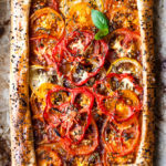 Tomato tart with seeds in a puff pastry crust.