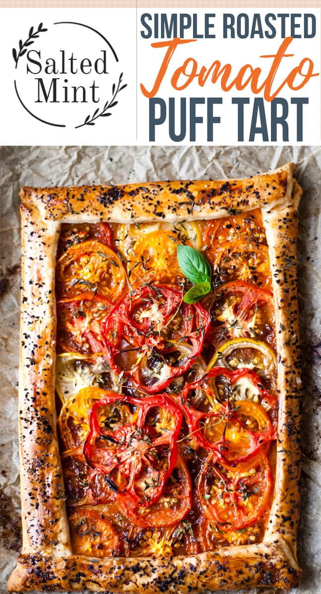 This simple roasted tomato tart uses beefy heritage tomatoes wrapped in the crispiest puff pastry and scattered with crunchy seeds. Those tomatoes are snuggled into a sticky onion jam to keep everything sweet and savory. Feel free to scatter this tart with honey, cheese or even truffle oil for the ultimate vegetarian dinner. Simply tomatoes, puff pastry pie crust, and some salt are all you need to make this perfect tomato tart. #easyrecipes #summerrecipe #vegetarian #fallrecipes