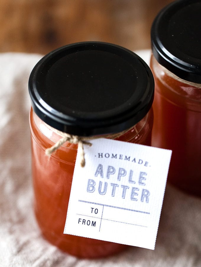 Apple butter in a jar with a gift tag.
