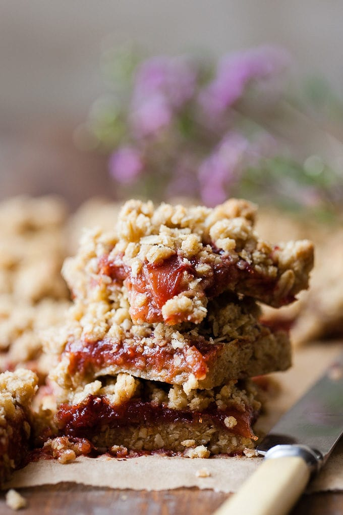 Stack of spiced plum crumble bars.