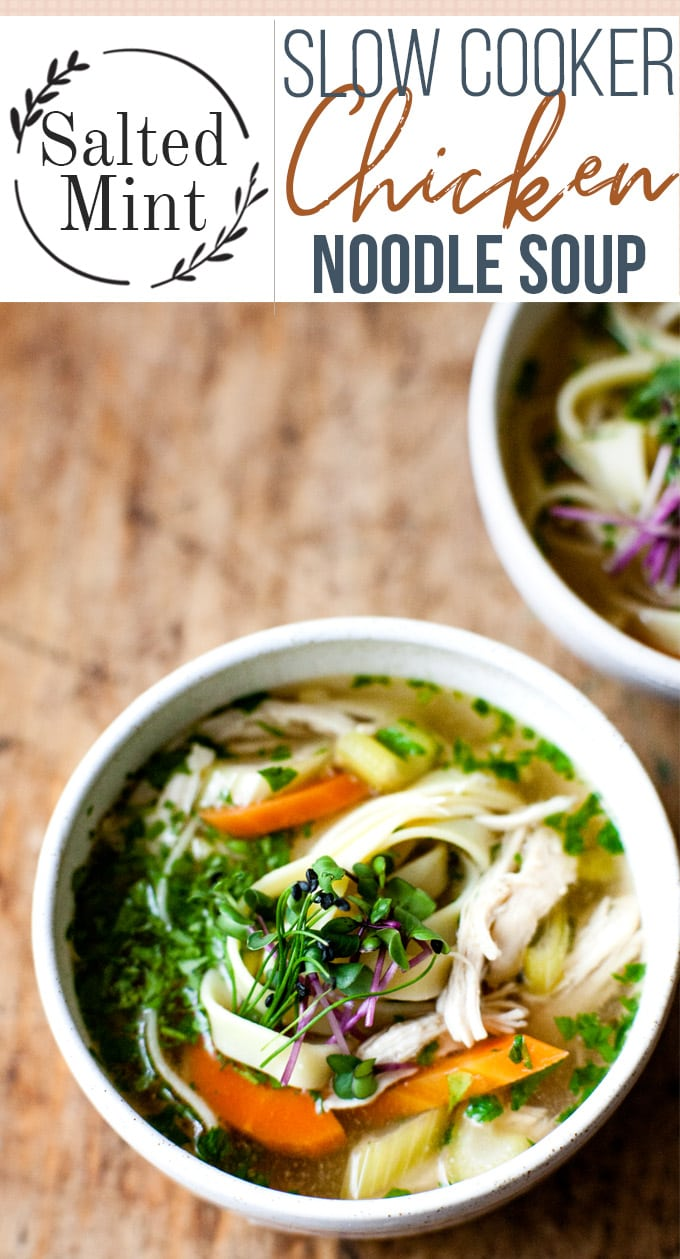 This easy and healthy slow cooker chicken soup is the perfect winter wellness soup. Use chicken breast or thighs and skip the noodles to keep it low carb. This soup is light and loaded with Asian flavors. Slow cook in your crockpot for 4-5 hours and have the most amazing soup ready without having to do any prep! Perfect for Slimming world or weight watchers diets too. #slowcooker #soup #easyrecipe