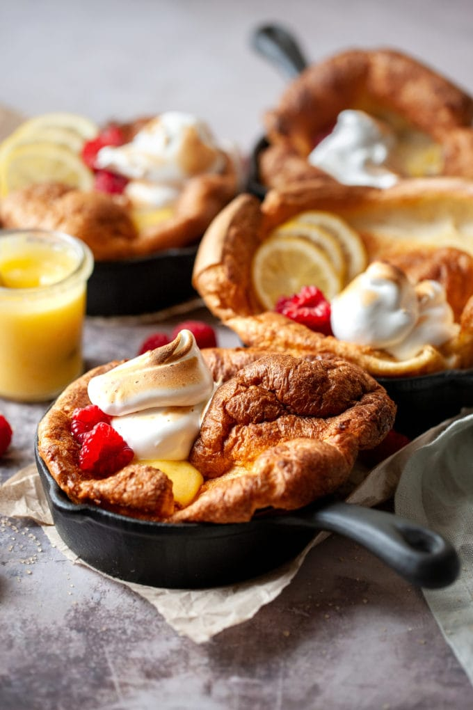 Lemon Meringue Dutch Baby in a cast iron skillet.