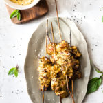 Oven grilled chicken skewers on a grey plate