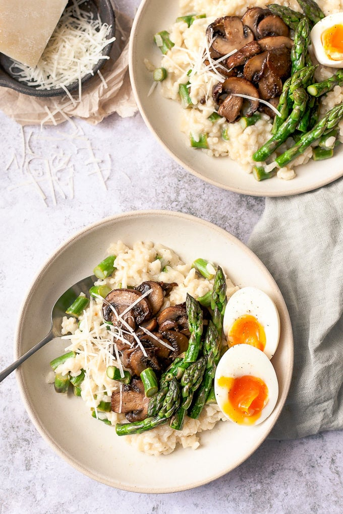 2 Bowls of asparagus risotto with soft boiled eggs